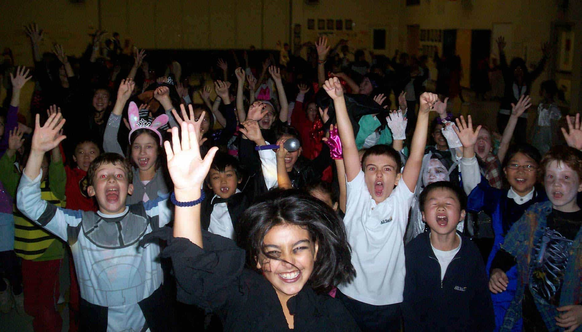 Happy cheering students at school dance
